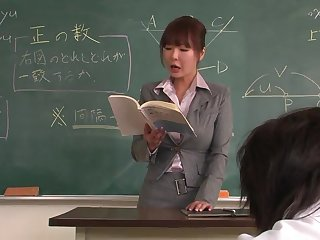 Lecturer helps a well-draped schoolgirl to concentrate on the lesson
