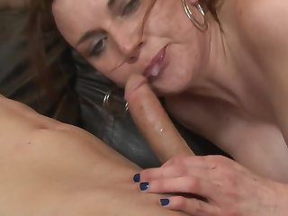 A brunette is handling a cock with her pretty hands really well