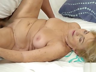 Blonde grandma gets a hard cock in her twat