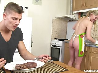 Blonde girlfriend drops on her knees in the kitchen to please her man