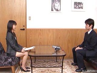 Japanese secretary Nana Nanami on her knees pleasing a fat shaft