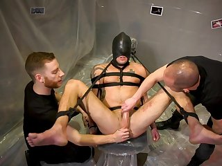 Gay lovers share their BDSM sex play in a kinky threesome