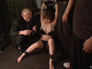 Busty Asian mature tied up and tortured by two horny dudes
