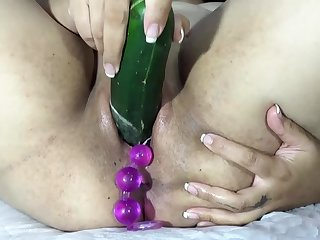 Playing to fuck cervix with big balls, carrot and dildo