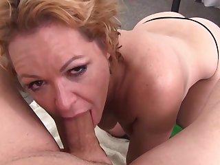 milf on her knees deepthoating a big cock