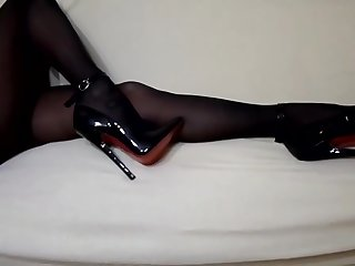 Nylon tights and extreme heels with red soles