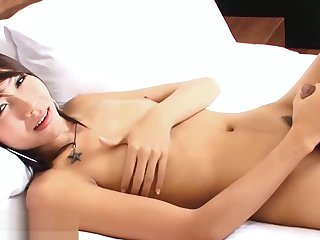 Flat chested ladyboy playing with her huge erected cock