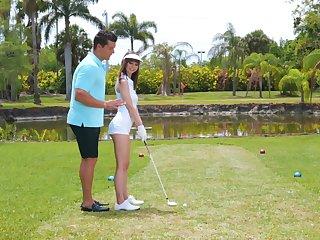 Golf tutor teaches amateur Shae Celestine how to handle a shaft