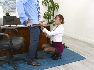 Redhead boss Jade Jantzen in stockings drops on her knees for a fat cock